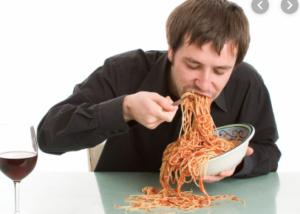 A Man eating a plate of Spaghetti. Foods To Avoid while on the ketogenic diet